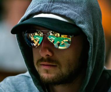 Hands of himself and others are reflected in a player's sunglasses during first day play in the World Series of Poker's Main Event at the Rio All-Suites Hotel and Casino on Sunday, July 5, 2015.