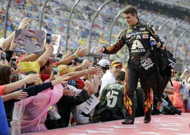 Jeff Gordon greets fans during driver introductions before the Daytona 500 at Daytona International Speedway on Sunday, July 5, 2015, in Daytona Beach, Fla. Gordon is retiring at the end of the season, and this will be his last race at Daytona.