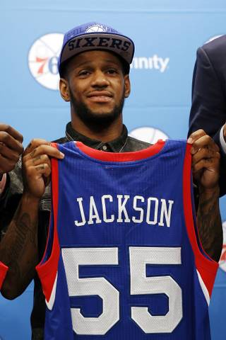 Newly drafted Philadelphia 76ers' Pierre Jackson poses for a photo after a basketball news conference at the team's practice facility, Saturday, June 28, 2014, in Philadelphia.