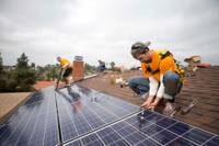 Vivint Solar employees install solar panels on a home. The company operates in 10 states.