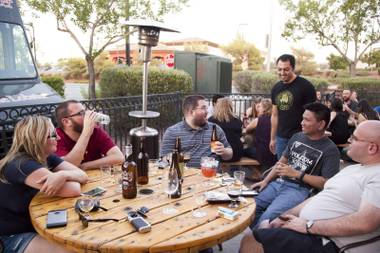 Welcome to Khoury's: Issa and his customers talk beer on the patio during a recent Wednesday night event.