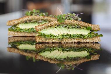Avocado, arugula and walnut pesto all work in sync within one of these great sandwiches.