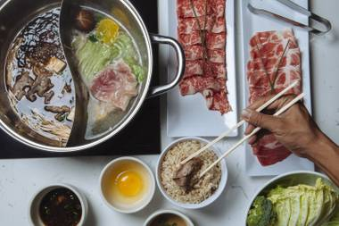 Yojie does a traditional sukiyaki, a shallow pot of sweet broth into which you dip each piece of meat before plunging the bite into raw egg.