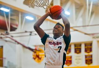 Andre Rafus (7) of Team Melo elevates for a dunk during the Bigfoot Hoops Las Vegas Classic at Eldorado High School on Thursday, July 23, 2015.