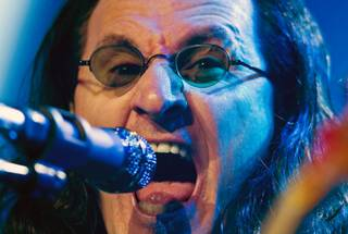 Geddy Lee of Rush performs for a packed house during their concert at MGM Grand Garden Arena on Saturday, July 25, 2015.
