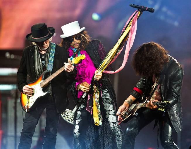 Aerosmith guitarist Brad Whitford, lead singer Steven Tyler and lead guitarist Joe Perry perform Saturday, Aug. 1, 2015, at MGM Grand Garden Arena.