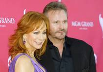 In this April 5, 2009, file photo, Reba McEntire and Narvel Blackstock arrive at the 44th Annual Academy of Country Music Awards at MGM Grand Garden Arena in Las Vegas.