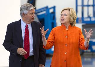Democratic presidential candidate and former Secretary of State Hillary Rodham Clinton talks with Bill Irwin Jr., executive director of the Carpenters International Training Fund, during a tour of the Carpenters International Training Center Tuesday, Aug. 18, 2015.