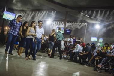 Guests walk across the dance floor while waiting for the next band to play at Broadacres Marketplace in Las Vegas, Nev. on Aug. 14, 2015.