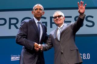 President Barack Obama poses with Senate Minority Leader Harry Reid (D-Nev) after Obama's keynote address during the National Clean Energy Summit 8.0 at the Mandalay Bay Convention Center Monday, Aug. 24, 2015.