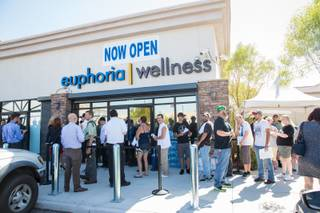 Dozens of customers wait in line to purchase marijuana on Monday, Aug. 24, 2015, opening day of Euphoria Wellness, the first marijuana dispensary in Las Vegas.