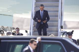 President Barack Obama steps off Air Force One as he arrives at McCarran International Airport on Monday, Aug. 24, 2015, in Las Vegas to give remarks at the National Clean Energy Summit 8.0.
