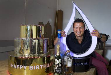Mike Pampinella, director of All American Design Center, poses in his studio workshop Monday, Aug. 31, 2015. Pampinella creates custom bottle service fabrications for nightclubs. The cake with colored LEDs was made for Omnia. The illuminated water drop bottle presentation, right, was created for Wet Republic.