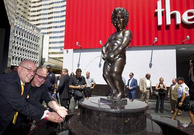 "The D Las Vegas headliners Adam London of ""Laughternoon"" and Kevin Burke of ""Defending the Caveman"" have fun with Manneken Pis Las Vegas after an unveiling at The D Las Vegas on Tuesday, Sept. 1, 2015, in downtown Las Vegas."