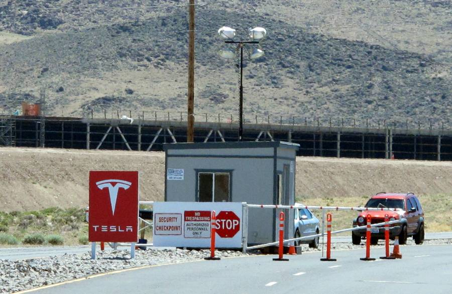 Framing of Tesla Motors' new factory under construction is visible June 14, 2015, behind a security gate on Electric Avenue at Tahoe Reno Industrial Center about 15 miles east of Sparks along U.S. Interstate 80.