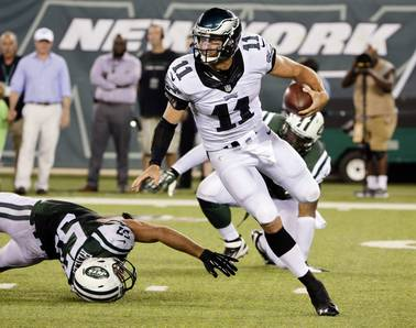Philadelphia Eagles quarterback Tim Tebow avoids a sack by New York Jets' Trevor Reilly (57) during the first half of a preseason NFL football game Thursday, Sept. 3, 2015 in East Rutherford, N.J.