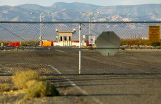 The road to Yucca Mountain is fenced off near Amagosa Valley Thursday, Aug. 27, 2015.
