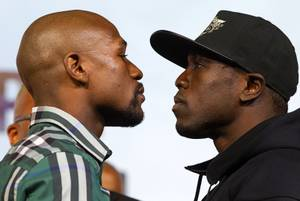 Undefeated WBC/WBA welterweight champion Floyd Mayweather Jr., left, faces off with challenger Andre Berto during a news conference at the MGM Grand Sept. 9, 2015. Mayweather will defend his titles against Berto at the MGM Grand Garden Arena Saturday in what he says will be his final fight.