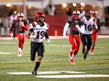 San Diego State's  Donnel Pumphrey runs 94-yards for a touchdown  against New Mexico during the second half of an NCAA college football game Friday, Oct. 10, 2014 in Albuquerque, N.M. Pumphrey rushed for a career-high 246 yards on 20 carries. San Diego State won 24-14. (AP Photo/Eric Draper)