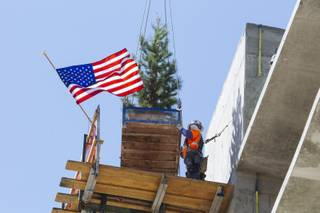 The PENTA Building Group hosted a topping off ceremony to celebrate the placement of the final concrete at the Lucky Dragon Hotel & Casino Construction Site in Las Vegas, Nev. on September 11, 2015.  As part of the ceremony, a ceremonial tree was placed on top of the concrete structural element and hoisted by crane into its final position.