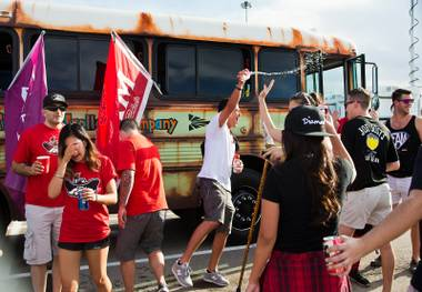 UNLV fraternity and sorority members begin to get rowdy in the parking lot as they party before the game versus UCLA at Sam Boyd Stadium on Saturday, September 12, 2015.