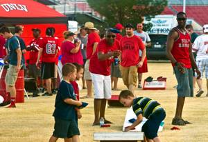 Tailgaters play some corn hole and party a bit before the game as UNLV faces UCLA at Sam Boyd Stadium on Saturday, September 12, 2015.