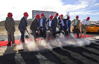 Aaron Fessler (4th right), co-founder and CEO of Speed Vegas, raises a fist during a ground breaking ceremony for Speed Vegas, a $30 million, 90-acre racetrack project on Las Vegas Boulevard south of the M Resort, Monday, Sept. 21, 2015. The project is expected to open in early 2016.