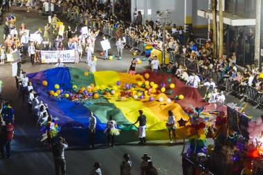 Participants march in the 17th annual PRIDE night parade in downtown Las Vegas, Friday Sept. 18, 2015.
