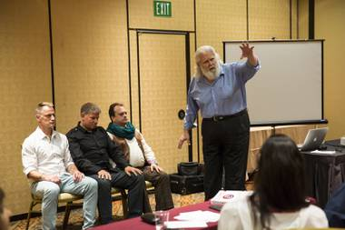 Doc Stevens, from Detroit Michigan, conducts a hypnosis session during a stage hypnosis training seminar at The Orleans, Tuesday Aug. 25, 2015.