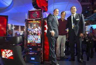 """TMZ on TV"" executive producer Harvey Levin is flanked by Victor Duarte, IGT global chief product officer for gaming, and Nick Khin, IGT senior vice president of North American sales and strategic accounts, during the second day of the Global Gaming Expo on Wednesday, Sept. 30, 2015, in Sands Expo Center at the Venetian."