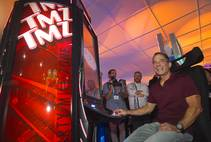 """TMZ on TV"" executive producer Harvey Levin tries out IGT's TMZ slot machine during the second day of the Global Gaming Expo on Wednesday, Sept. 30, 2015, in Sands Expo Center at the Venetian."