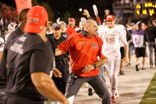 UNLV's coach Tony Sanchez celebrates his first Fremont Cannon win during the Mountain West game between the UNLV Rebels and the UNR Wolfpack at Mackay Stadium on Saturday, Oct. 3, 2015, in Reno.