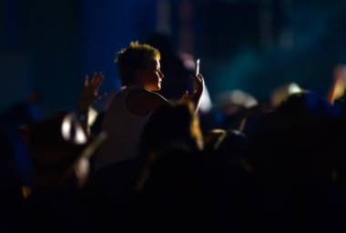 A young fan sits atop shoulders and makes an image at the Main Stage during the Route 91 Harvest Country Music Fest on Saturday, Oct. 3, 2015, at Las Vegas Village.