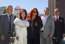 Naomi and Wynonna Judd — The Judds — stand with John Nelson, senior vice president of AEG Live, Bobby Reynolds, vice president of booking for AEG Live, and Pete Boyd, senior vice president of operations at the Venetian, onTuesday, Oct. 6, 2015, at the Venetian. Reuniting for the first time in nearly five years, the mother-daughter duo will perform at the Venetian Theater from Oct. 7-24.