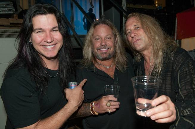 Vince Neil, center, joins his friends from Slaughter, who headlined Downtown Las Vegas Events Center on Friday, Oct. 2, 2015.