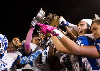 Basic players celebrate their Henderson Bowl victory at Green Valley High School on Friday, Oct. 9, 2015.