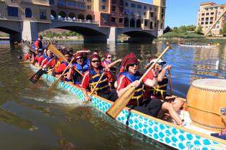 Participants attend the Rose Regatta Dragon Boat Festival at Lake Las Vegas on October 10, 2015.