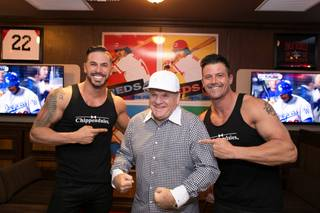 Mikey Perez and Nathan Minor of Chippendales at the Rio flank Pete Rose at the Pete Rose Bar and Grill grand opening Tuesday, Oct. 13, 2015, at Hawaiian Marketplace on the Strip.