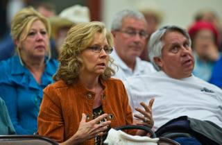 Beatty resident Teresa Sullivan expresses her concerns during the town hall meeting about the lack of emergency personal available in the area with the recent fire at US Ecology near Beatty, Nevada, a good example of why more is needed on Tuesday, October 20,  2015.