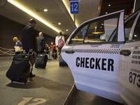 Travelers arriving at McCarran International Airport make their way through the taxi queue in Las Vegas on Friday, March 1, 2013. Passengers will soon be able to hire rides from ride-hailing services at the airport.