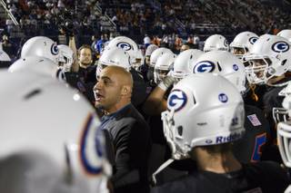 Bishop Gorman Coach Kenny Sanchez addresses his team vs. Don Bosco of New Jersey, Friday, Oct. 23, 2015.