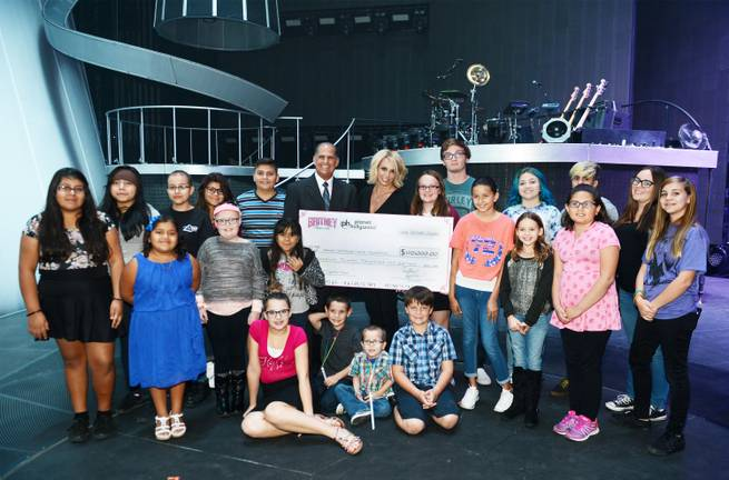 Britney Spears presents a check for $120,000 to Nevada Childhood Cancer Foundation on Saturday, Oct. 24, 2015, at Planet Hollywood.