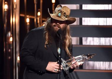 Chris Stapleton accepts the award for new artist of the year at the 49th Annual CMA Awards at Bridgestone Arena on Wednesday, Nov. 4, 2015, in Nashville, Tenn.