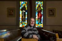 Father Max Oliva is a priest who has written a book on the moral and ethical practices people should use when engaging in business transactions. The author of 7 books lives near the St. Christopher Catholic Church and is a fan of the stained glass in its chapel.