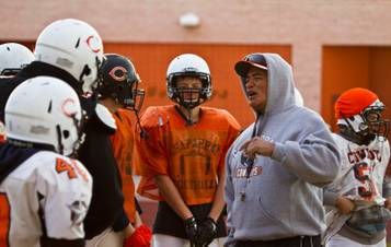 Chaparral High School football head coach Paul Nihipali has words of encouragement for his players as they practice Tuesday, Nov. 10, 2015, for their upcoming state semifinals game.