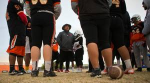 Chaparral High School football offensive coach Lito Soifua talks his players through some possible options their opponent may use as they practice on Tuesday, November 10, 2015.  They are in the state semifinals for the first time since 1990.