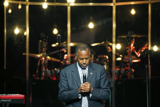 Republican presidential candidate Dr. Ben Carson prays before speaking Sunday, Nov. 15, 2015, at the International Church of Las Vegas. Carson spoke at the church ahead of a scheduled rally in Henderson.