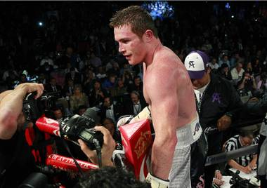 Canelo Alvarez of Mexico celebrates his victory over Miguel Cotto of Puerto Rico after their middleweight fight at the Mandalay Bay Events Center Saturday, Nov. 21, 2015.