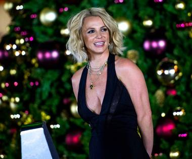 Planet Hollywood headliner Britney Spears lights a 30-foot Christmas tree Saturday, Nov. 21, 2015, at the Linq Promenade. The holiday event also included young Christmas carolers and dancers.