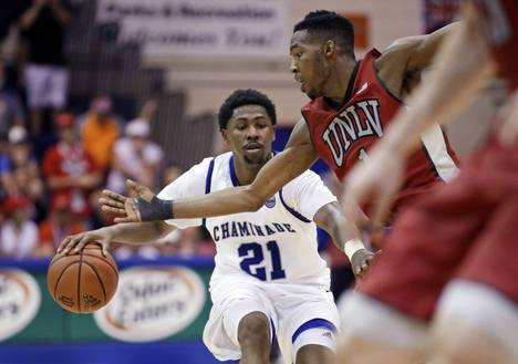 Chaminade guard Rohndell Goodwin (21) brings the ball up as UNLV forward Derrick Jones Jr. (1) defends during the second half of an NCAA college basketball game in the second round of the Maui Invitational, Tuesday, Nov. 24, 2015, in Lahaina, Hawaii. UNLV won 93-73.